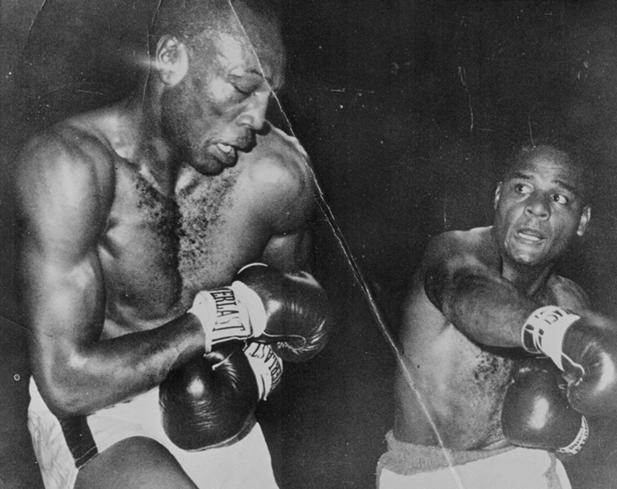 Folley hammers Bob Foster on December 6, 1965, at a bout in New Orleans' Municipal Auditorium; Photo courtesy Chandler Museum
