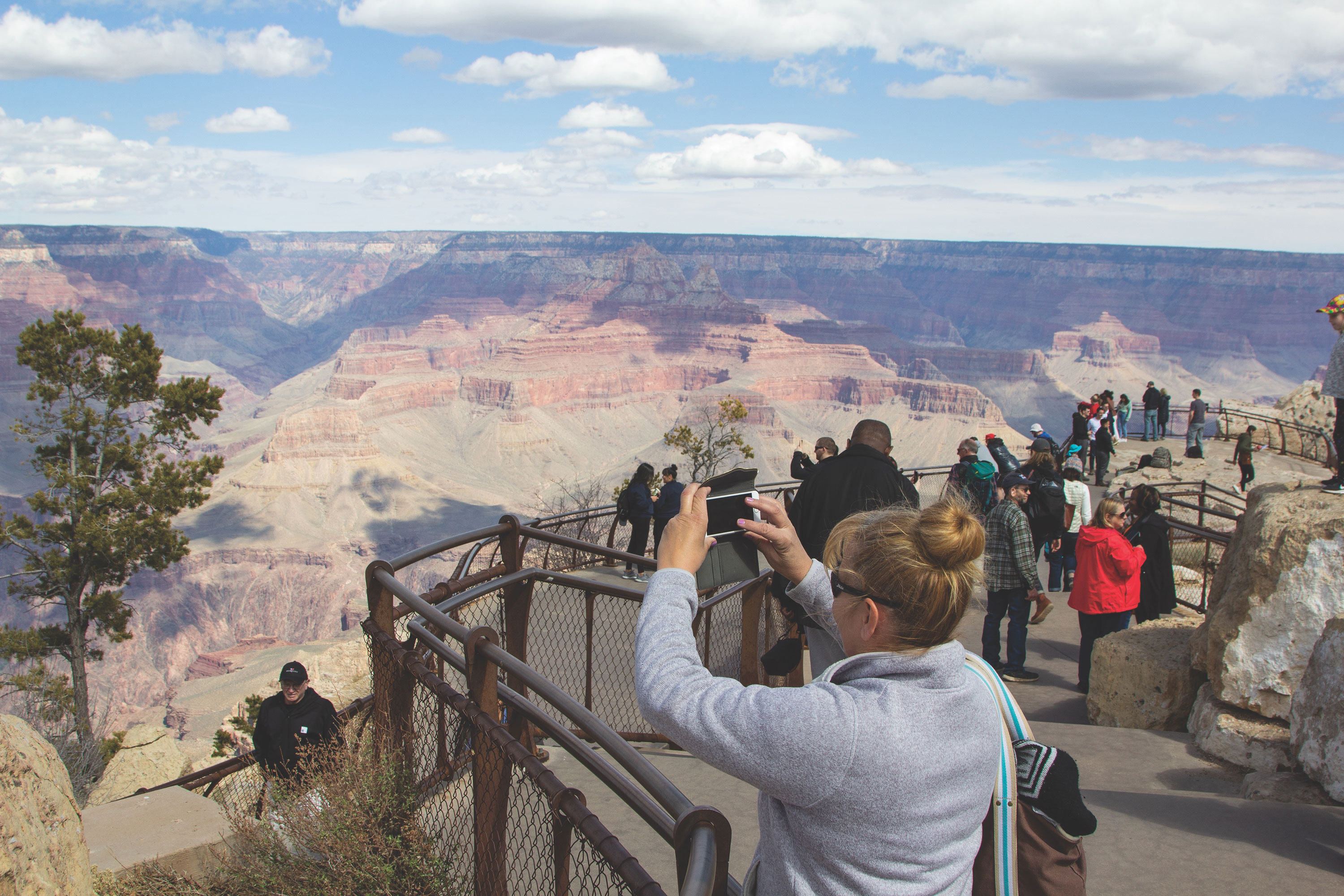 The writer's mom, Anja DesJardins, gets her first view and photos of the Grand Canyon at Desert View Watchtower.