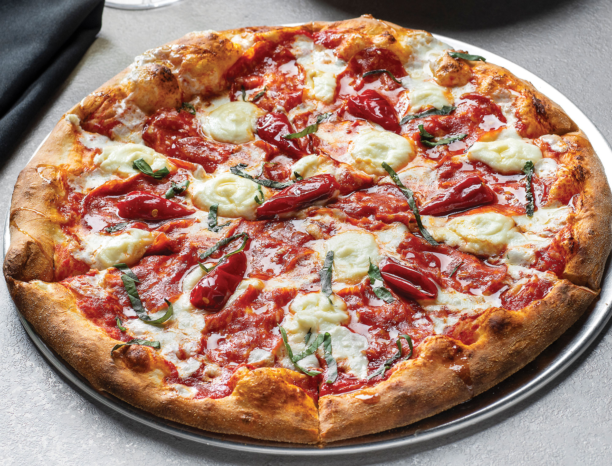 Diavolo pizza at Osteria Mia; Photography by Rob Ballard
