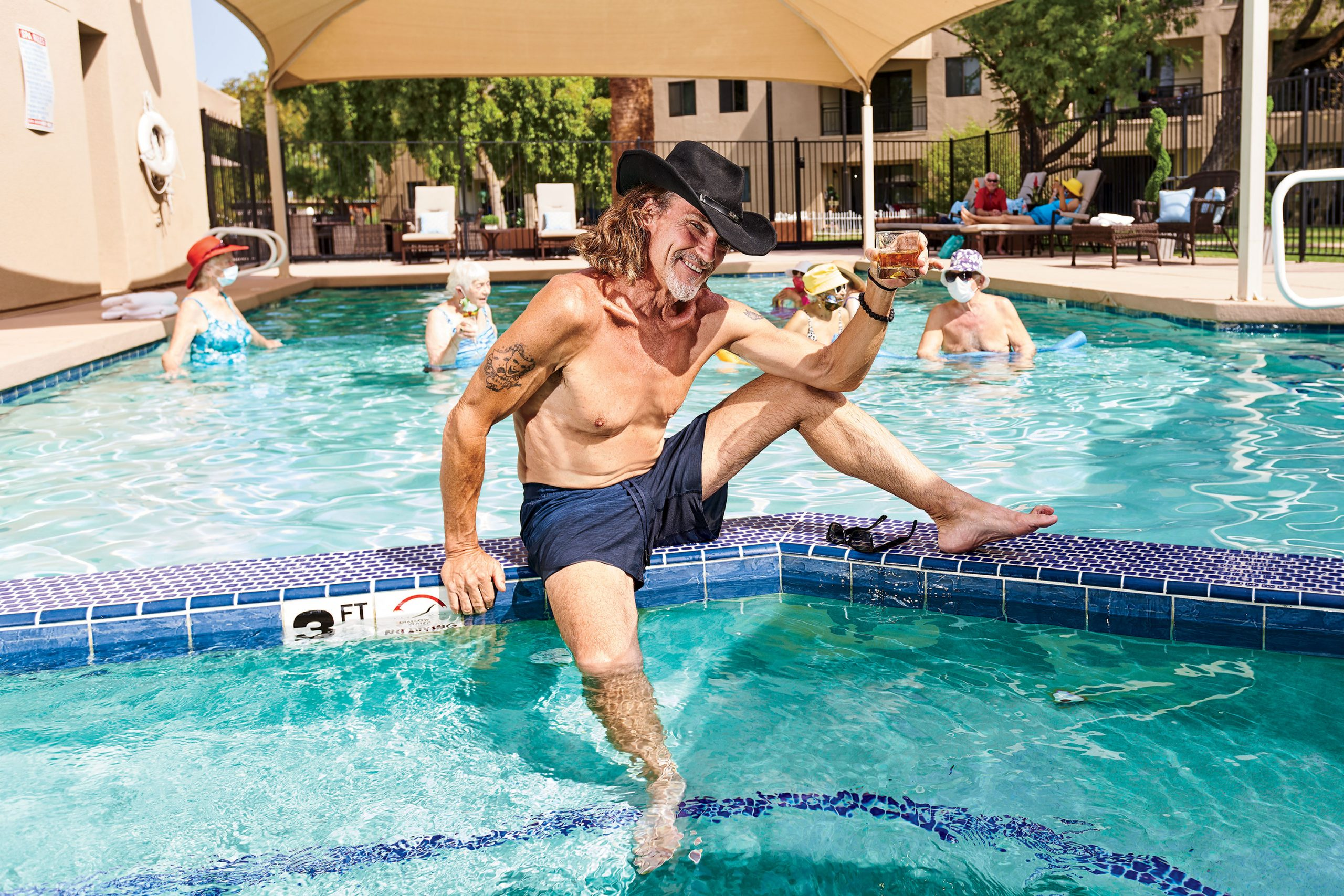 Soakin' up a day of retirement with sun-loving residents at the pool of The Palazzo senior living.; Original photography by Camerawerks
