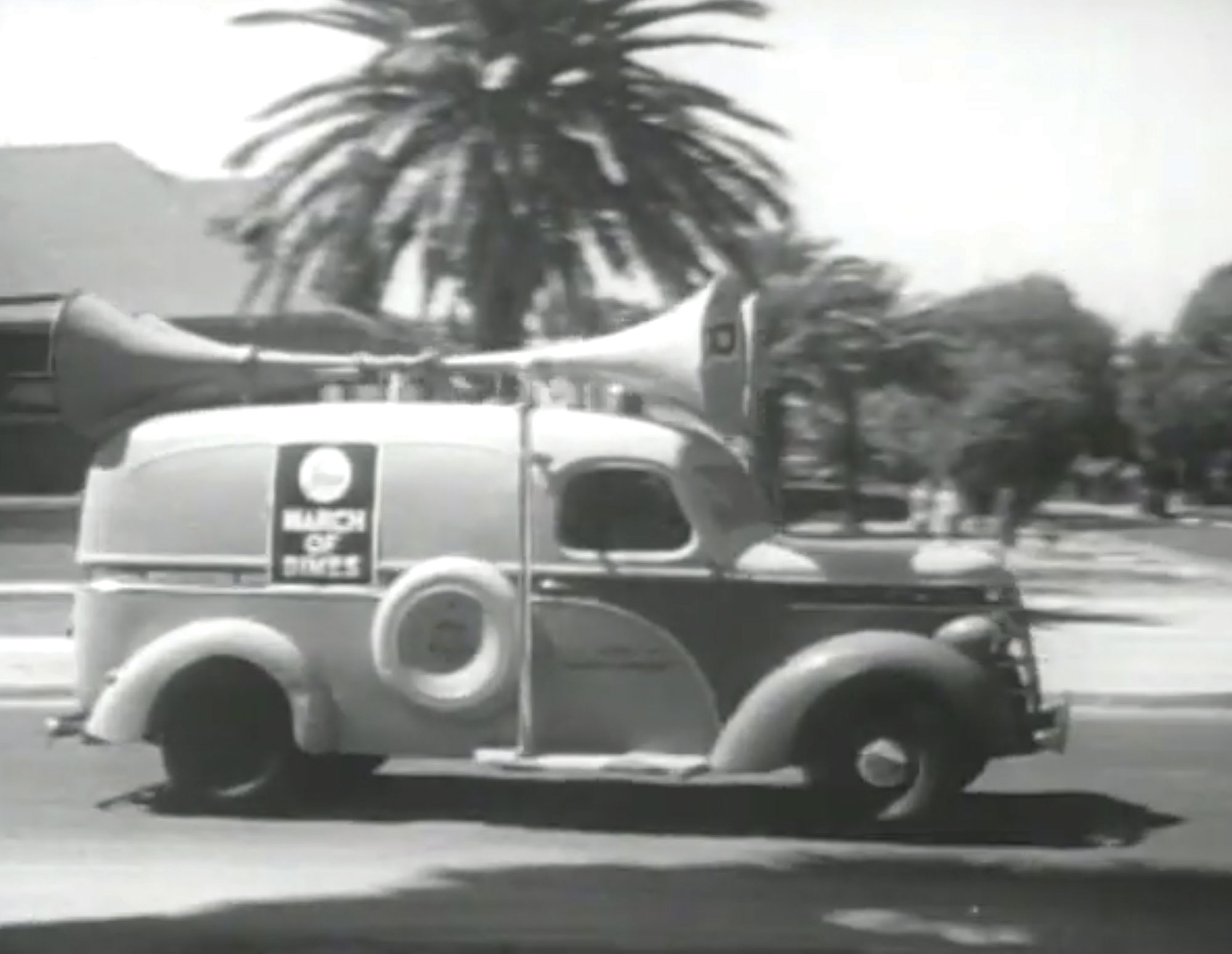 Sound trucks drive through Phoenix, announcing the original Mothers March in 1950