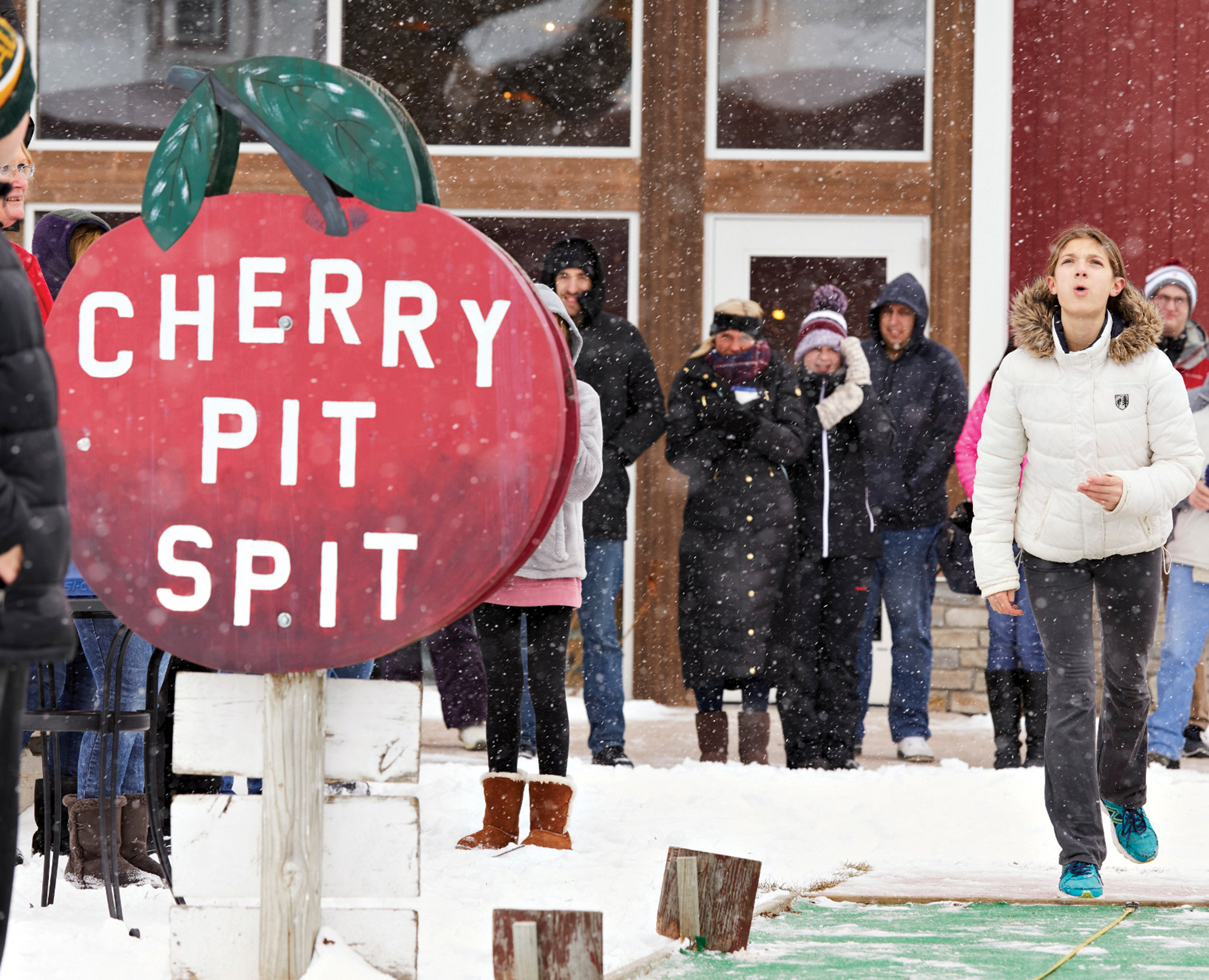 a pre-COVID cherry-pit-spitting competition at Lautenbach's Orchard Country