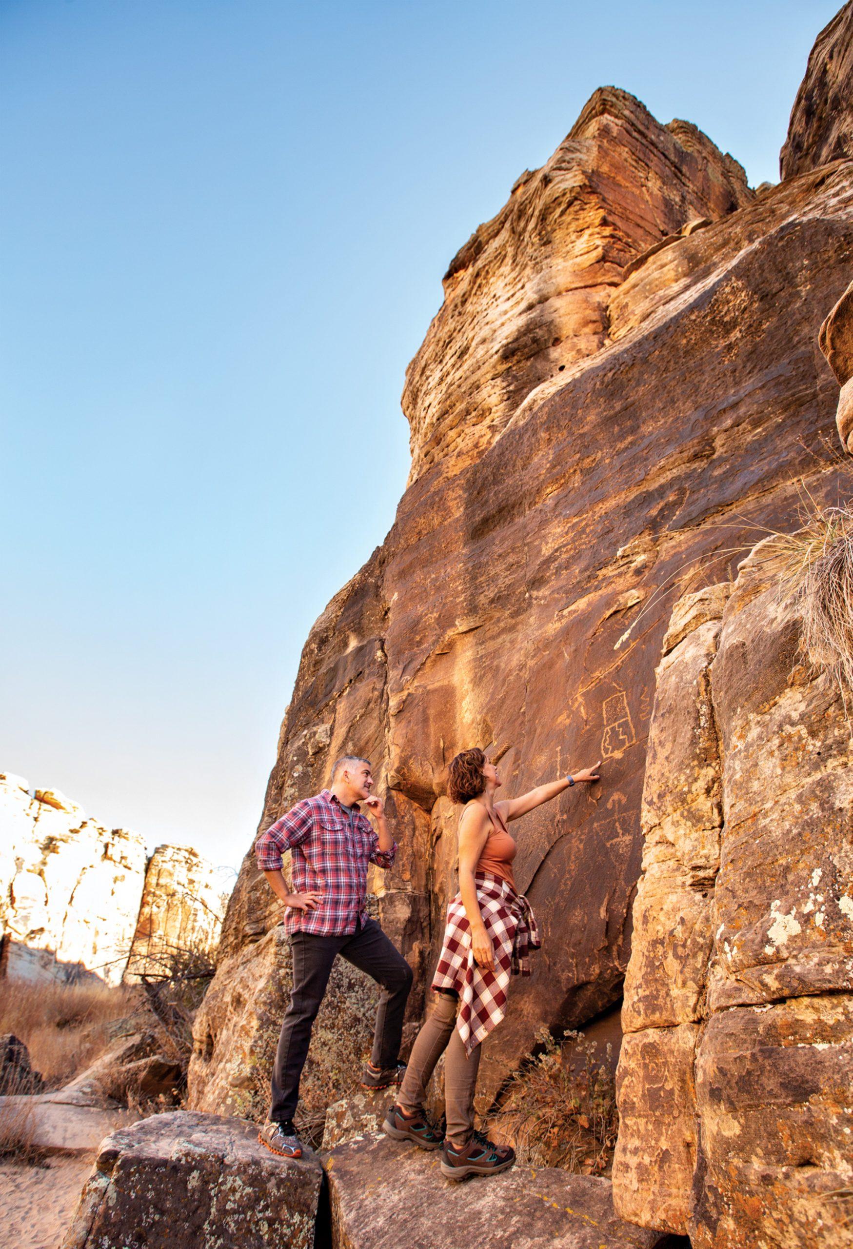 petroglyphs at Rock Art Ranch; Photo by Kevin Kaminski; Models: Cat Hartmann & Torin Sixx/Ford Robert Black Agency