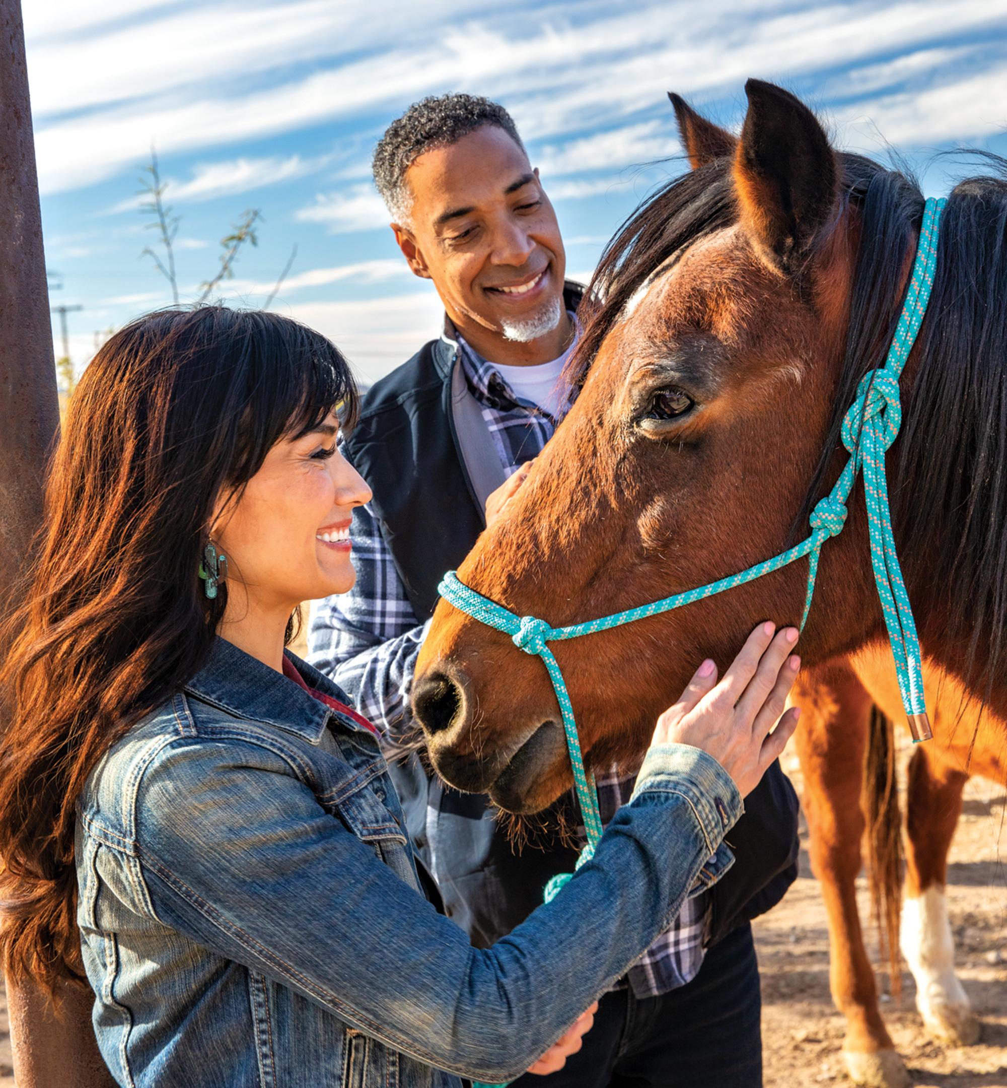 Neighboring horses; Photo by Kevin Kaminski; Models: Lauren Alonzo & Russell Scott/Ford Robert Black Agency