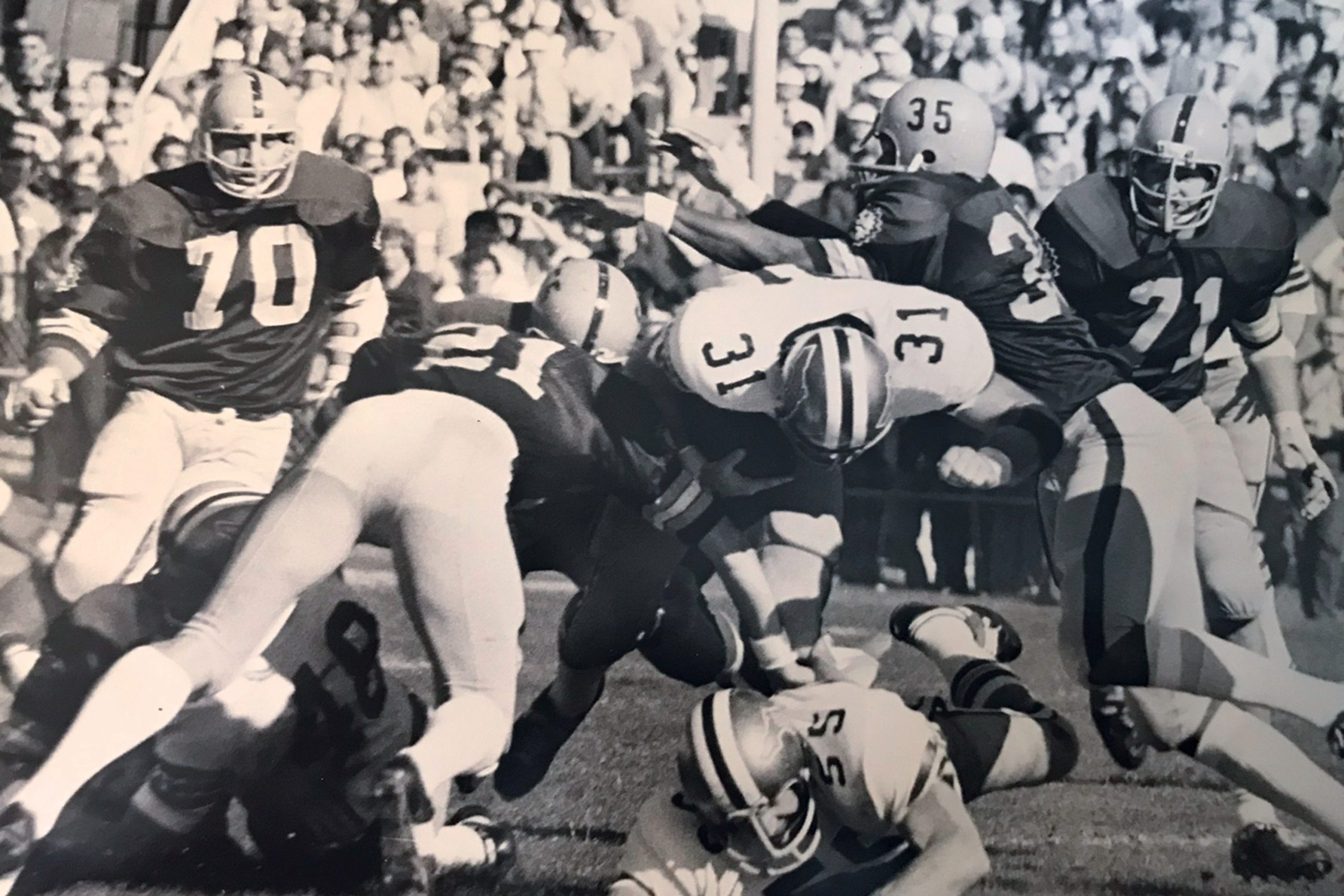 ASU safeties Mike Clupper (No. 21) and Ron Lumpkin tackle Florida State University fullback Paul Magalski during the 1971 game; Photo courtesy Mike Clupper