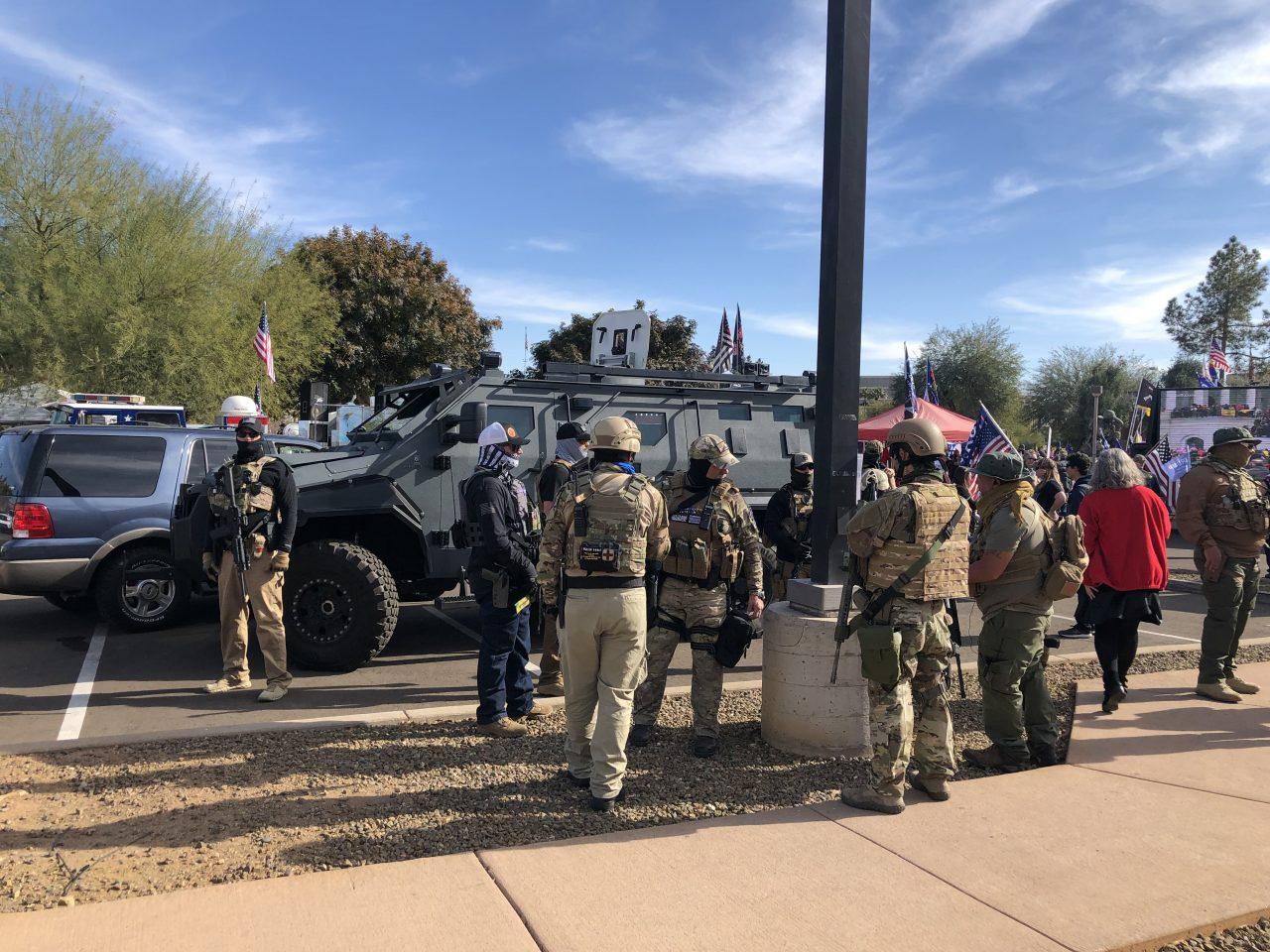 https://www.phoenixmag.com/wp-content/uploads/2021/01/Militia-gathered-by-Pit-Bull-VX-van-1280x960.jpg