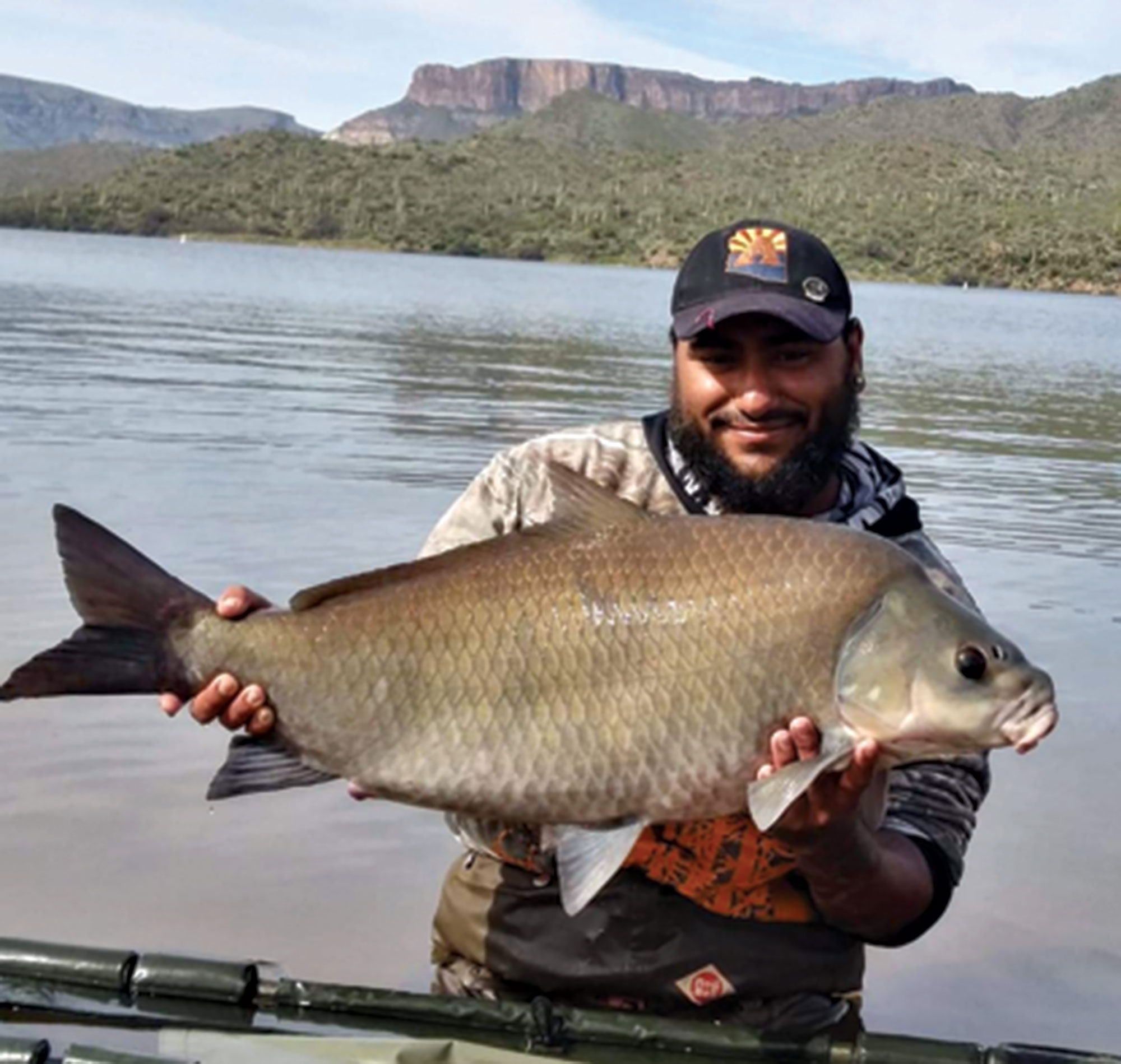 Ron Longoria holds his state record buffalo fish catch, March 2020; Photo courtesy Ray Longoria
