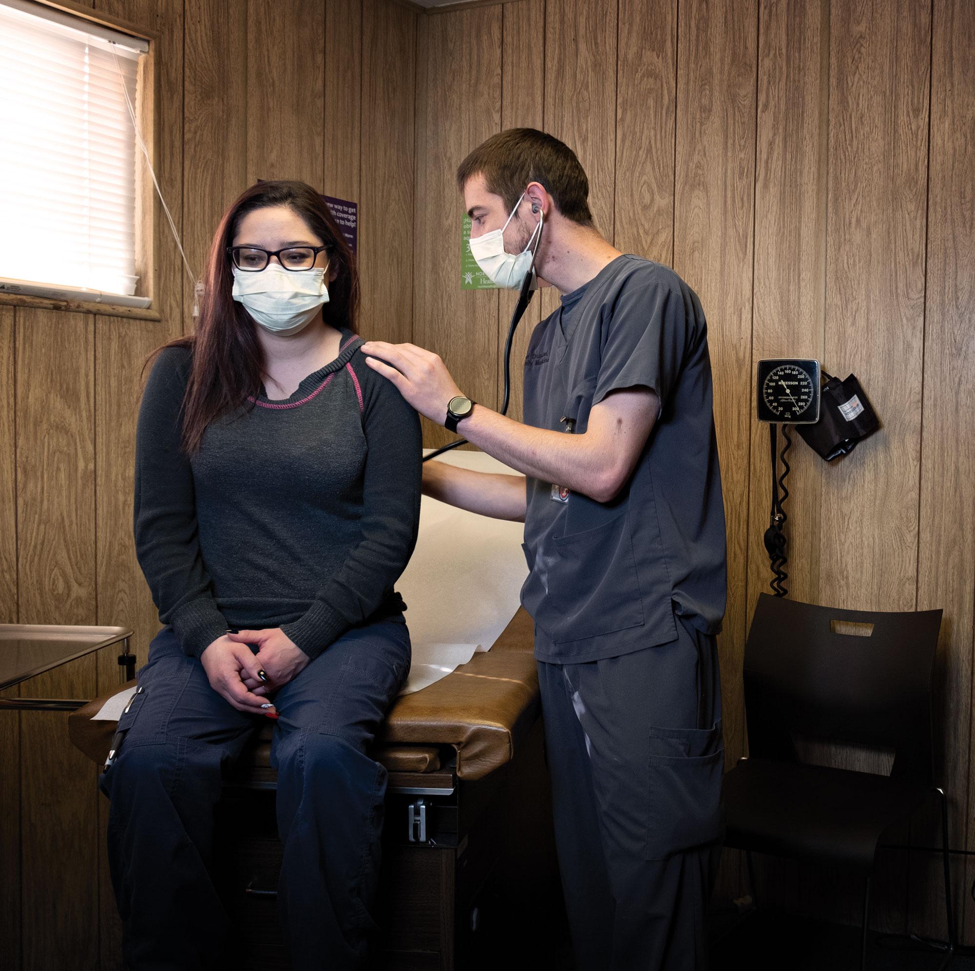 Dr. Druschel examines a patient in his Seligman practice; Photo by Mirelle Inglefield