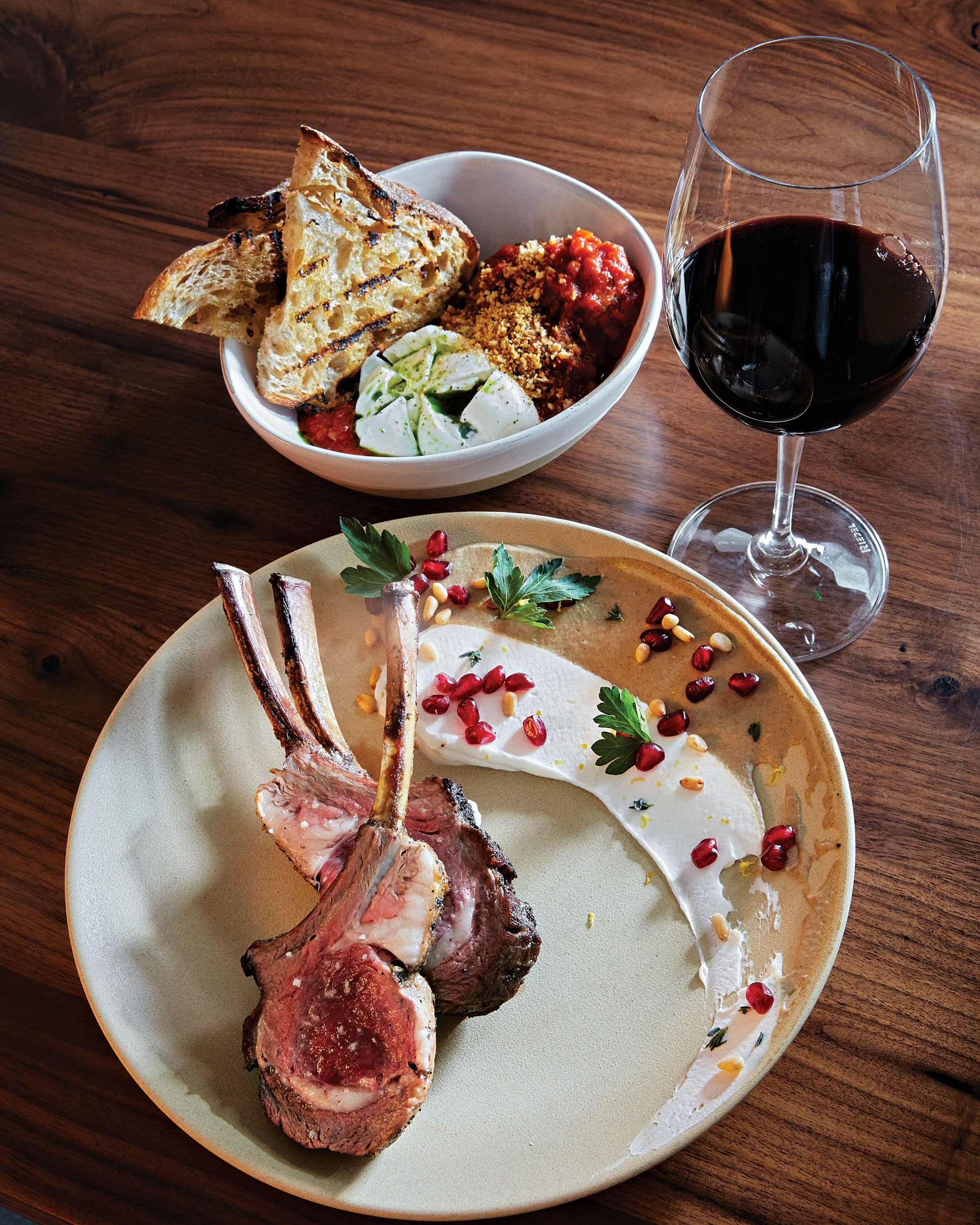 Lamb rack with puréed eggplant, below, and burrata and meatballs at Character; Photo by David B. Moore