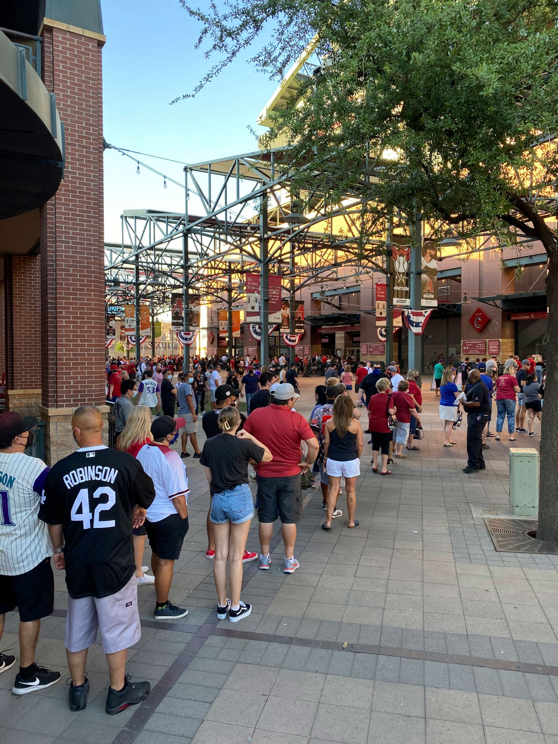 Fans wait in long lines to get inside Chase Field for Opening Day 2021. Photo by Matthew Johnson/PHOENIX magazine