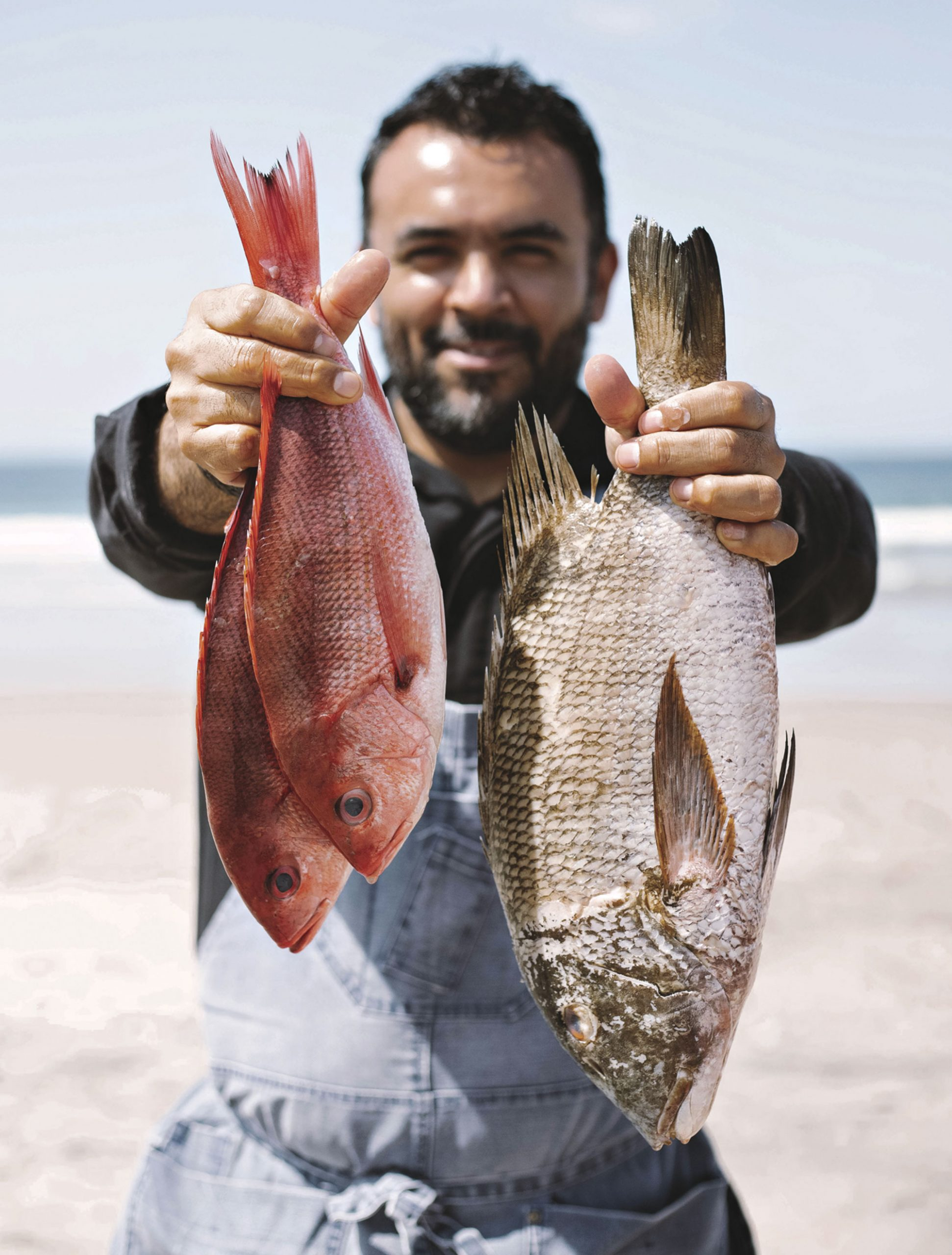 Chef Victor Palma with the day's sea-to-table catch; Photo by Bronwyn Knight