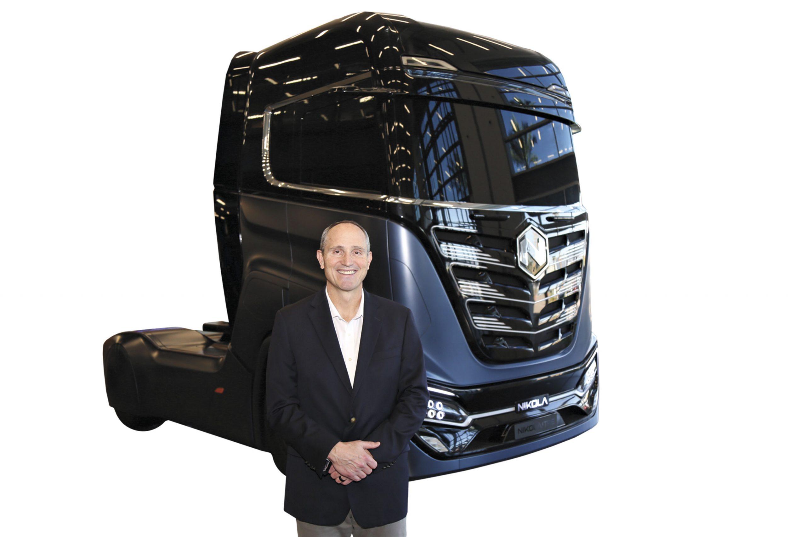 CEO Mark Russell with Nikola's model Tre semi-truck; Photo by Angelina Aragon