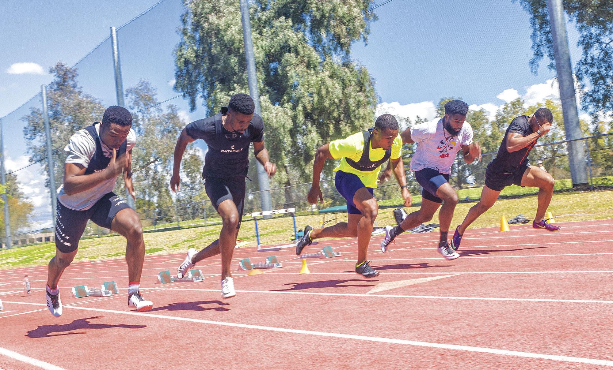 Sprinters left to right: Dushos Itsekiri, Anaso Jobodwana, CJ Ujah, Ameer Webb, Chris Royster; photo by James Patrick