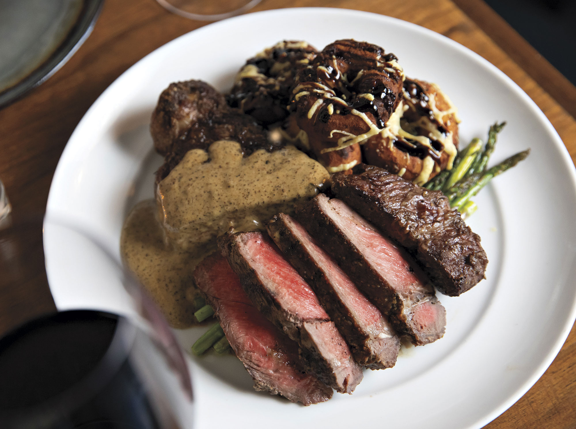 ancho-crusted steak with peppercorn sauce; Photography by Melissa Valladares