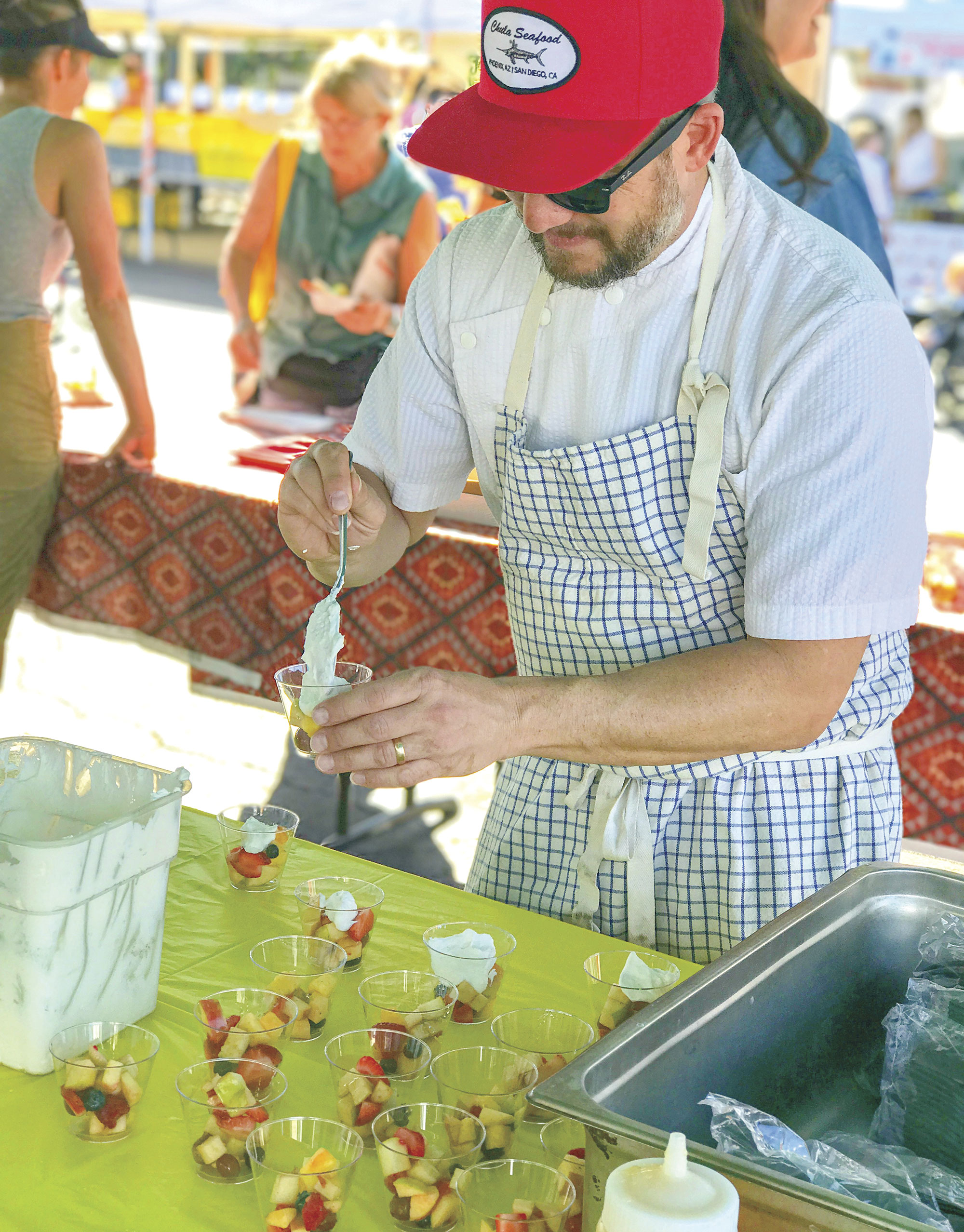 Chef Doug Robson does a culinary demo at Uptown Farmers Market; Photo courtesy Uptown Farmers Market