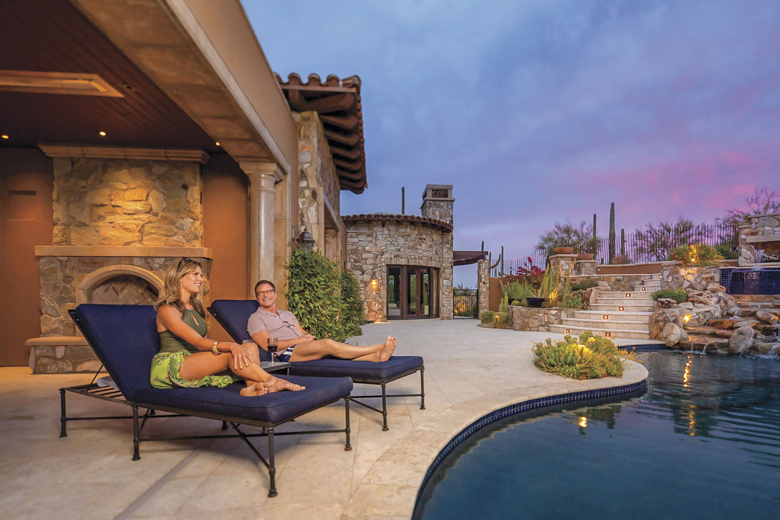 residents lounging by the pool; Photo courtesy Desert Mountain